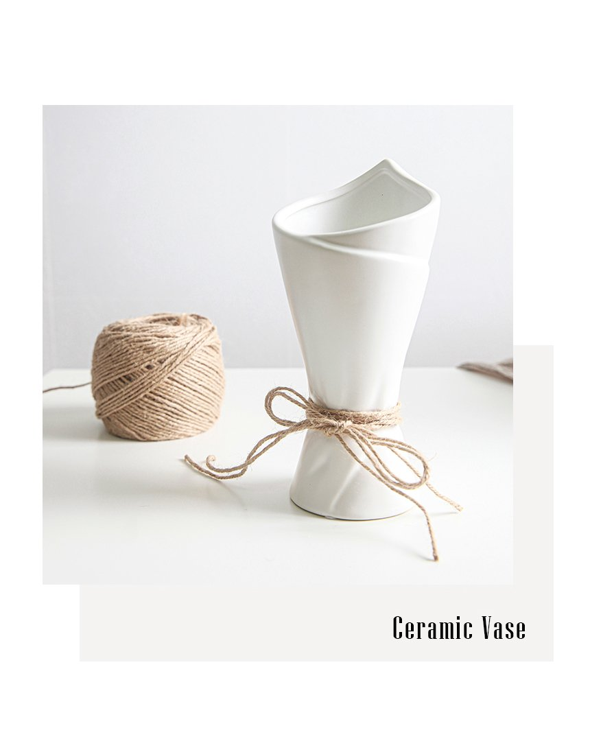 WHITE_SIMPLEELLIPSE_CERAMIC_VASE_02.jpg